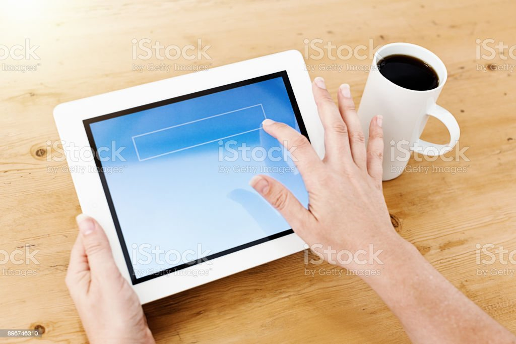 Female hands tap the screen of a digital tablet stock photo