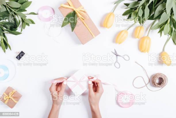 Female hands tie a pink ribbon box with gifts picture id638364428?b=1&k=6&m=638364428&s=612x612&h=c218joxu ejxef vxnthdai3567 v0jq5htpkhgnnau=