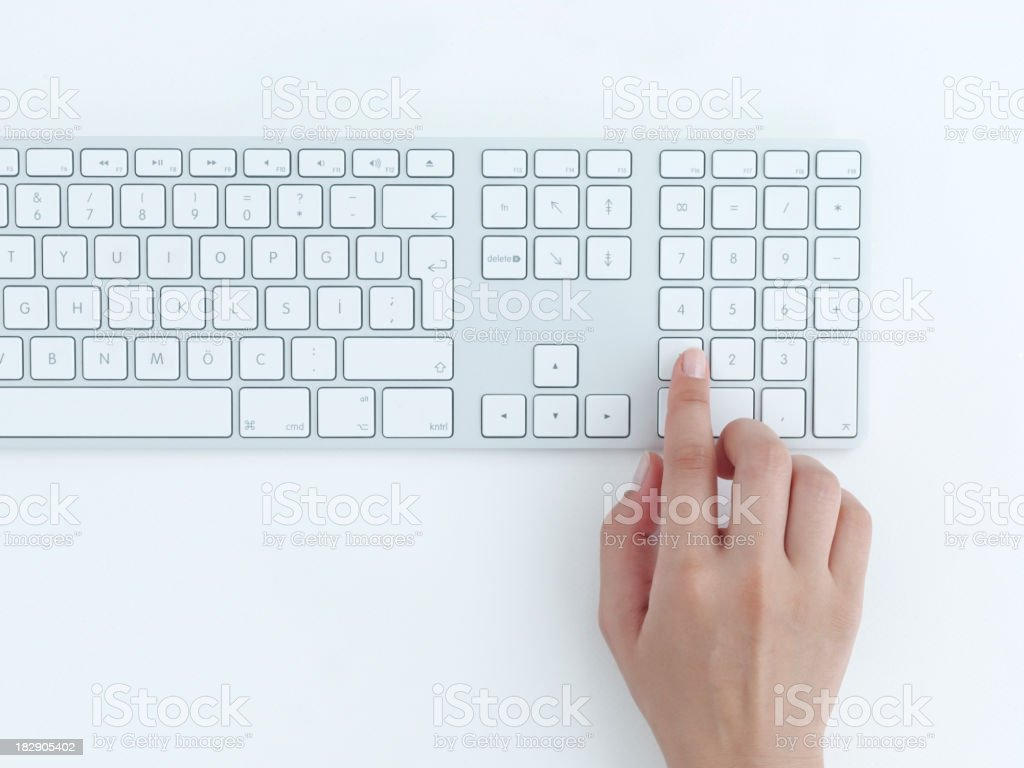 Female hands typing on a white computer keyboard royalty-free stock photo