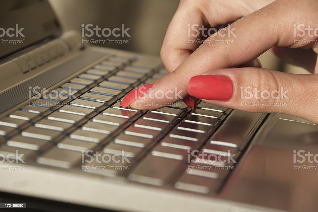 female hands typing on the keyboard laptop royalty-free stock photo