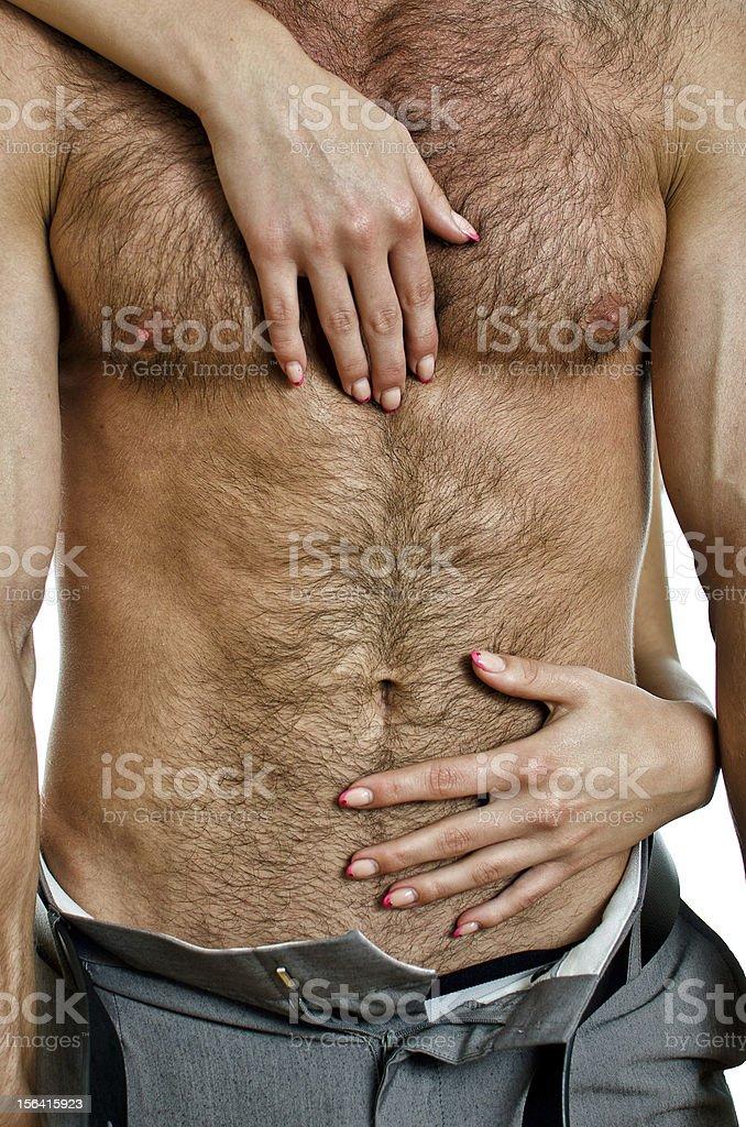 Female hands unbuckle mans pants. stock photo