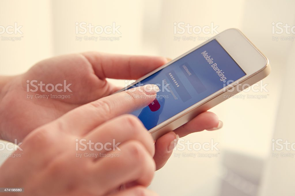 Female hands using mobile banking stock photo