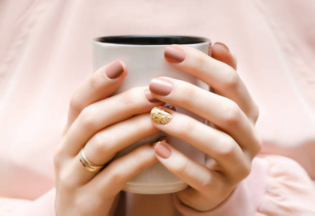Female hands with beige nail design. stock photo