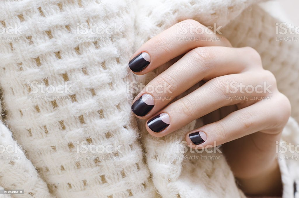 Female hands with dark brown nail design stock photo