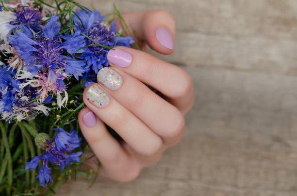 Female hands with pink nail design stock photo