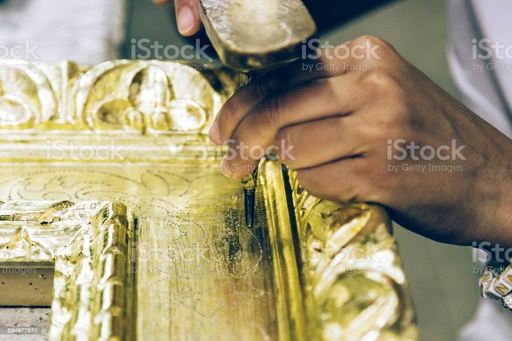Female hands working on a picture frame stock photo