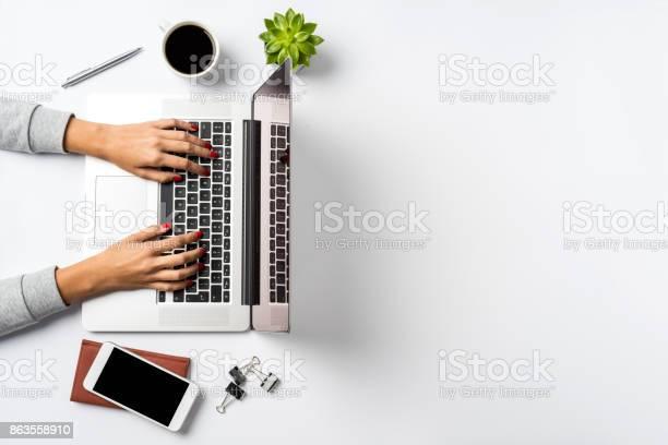 Female hands working on modern laptop office desktop on white picture id863558910?b=1&k=6&m=863558910&s=612x612&h=nvtdfuf5vbuletg8ojakdhsarbwqau7rglz5oo4aot8=