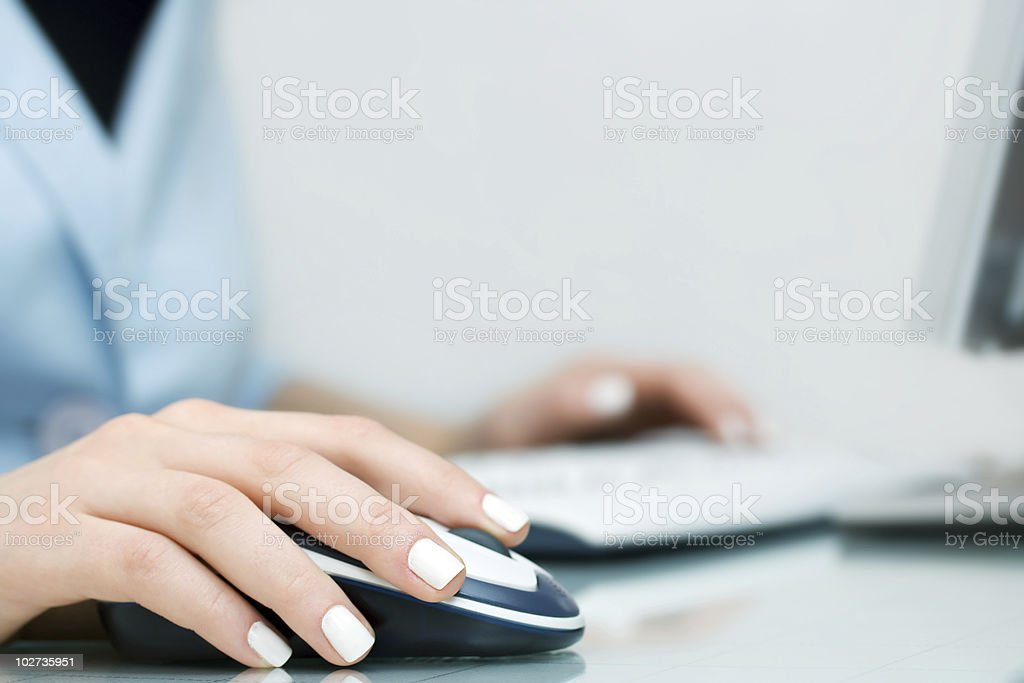 Female hands working on PC royalty-free stock photo