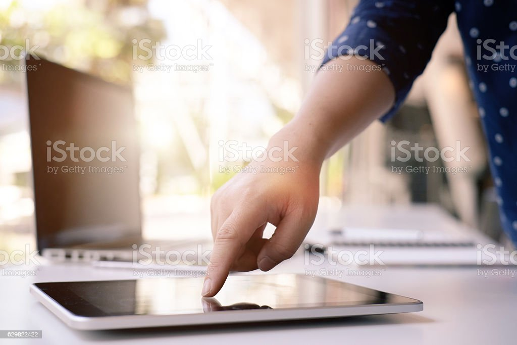 female hands working with tablet computer. stock photo