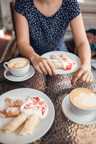 female have a lunch with coffee and pancakes, - nails ice cream imagens e fotografias de stock