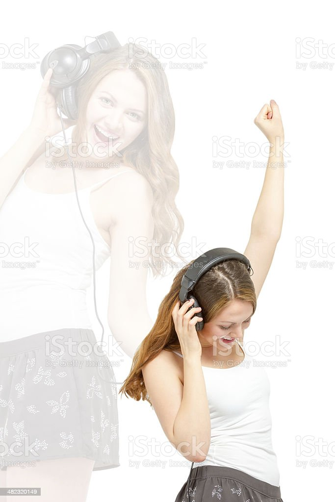 Female having fun listening to headphones stock photo