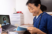 istock Female health care workers having video conference 1221620197