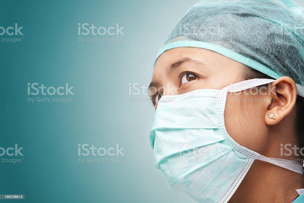 Female health worker looking away stock photo