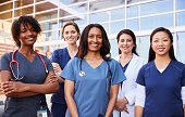 istock Female healthcare colleagues standing outside hospital 998313770