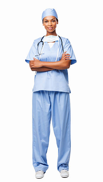 Female Healthcare Professional In Scrubs - Isolted Full length portrait of an African American female healthcare professional in scrubs. Vertical shot. Isolated on white. surgical cap stock pictures, royalty-free photos & images