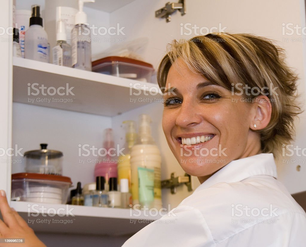 Female healthcare worker opening cupboard royalty-free stock photo