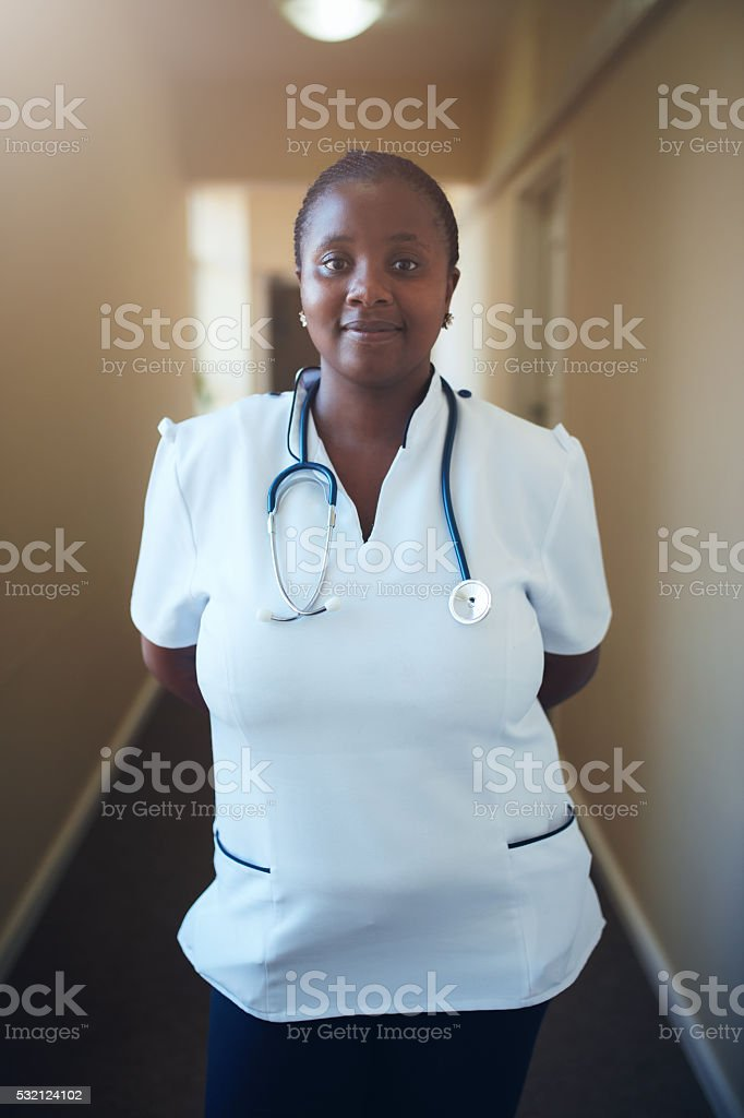 Female healthcare worker standing in hallway stock photo