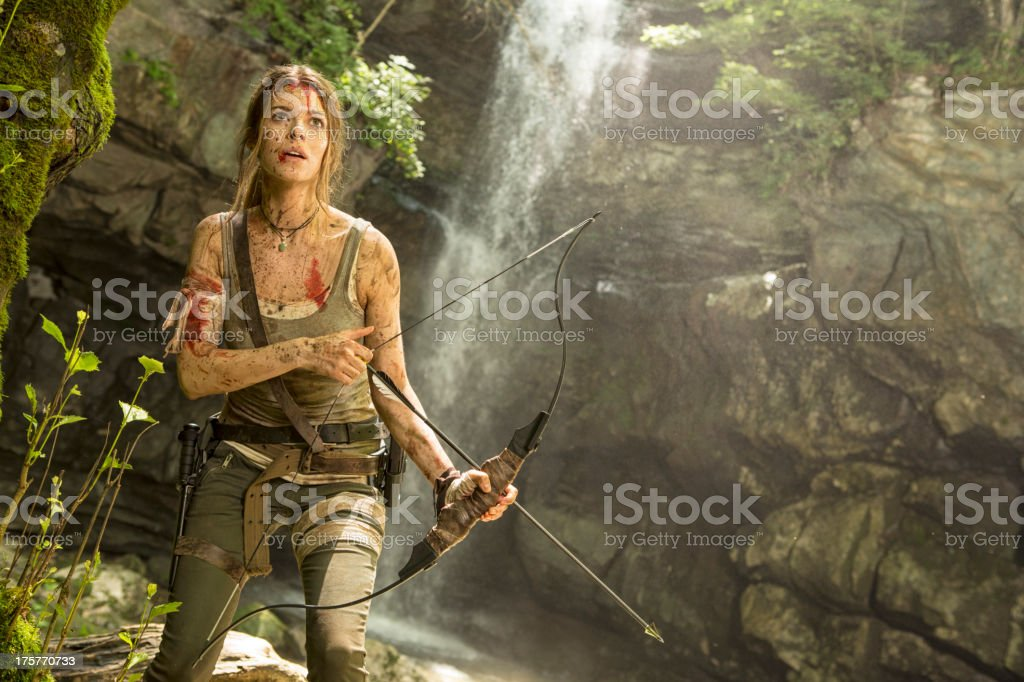 Female Heroine in the Jungle Hunting with Bow and Arrow royalty-free stock photo