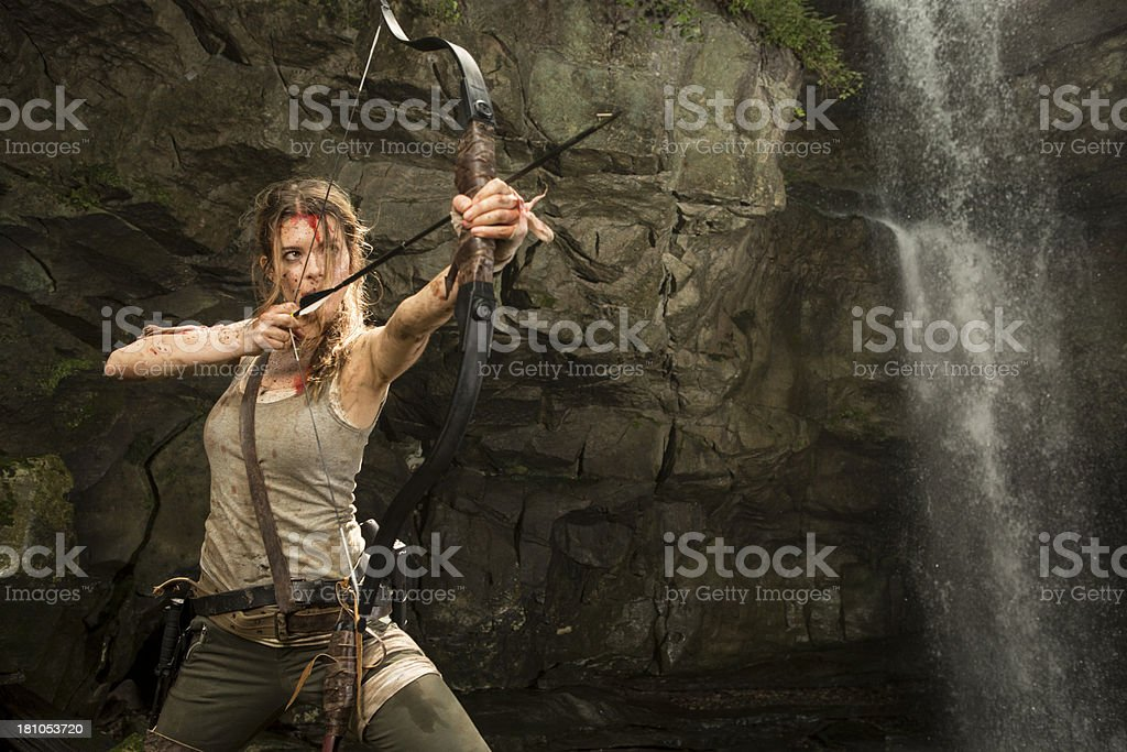 Female Heroine in the Jungle Hunting with Bow and Arrow stock photo
