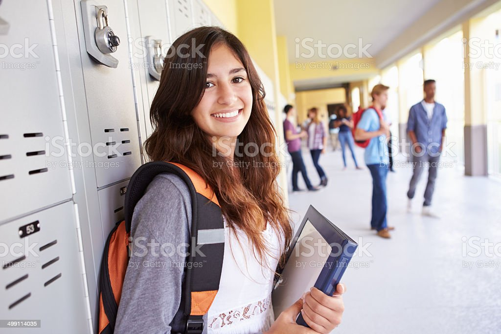 Female High School Student Standing By Lockers stock photo