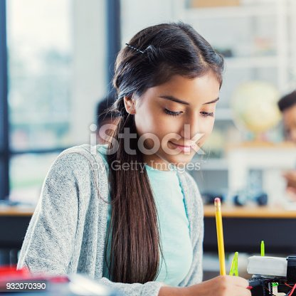 istock Female high school student works on class assignment 932070390