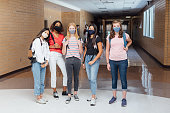 istock Female High School Students at School during COVID-19 1264881346