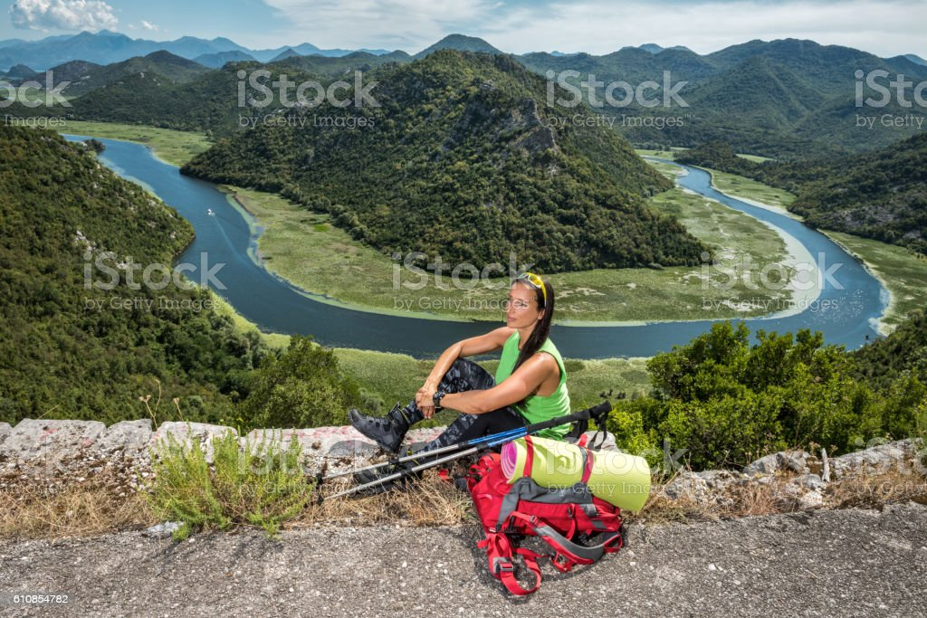 Female hiker at Rijeka Crnojevica, Montenegro stock photo