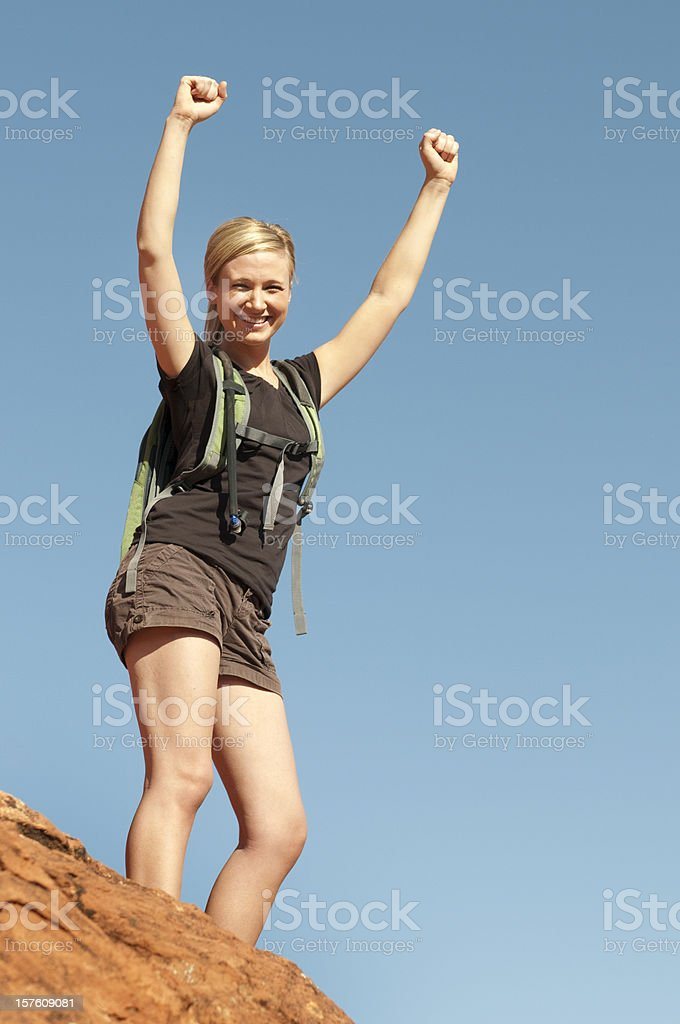 Female Hiker at the Top of a Hill royalty-free stock photo