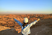 Female Hiker Excited with the Moon Valley or Valle de la Luna in Atacama Desert, Northern Chile, (Self Portrait)