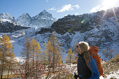 istock Female hiker exploring snow covered mountains, autumn 956844868