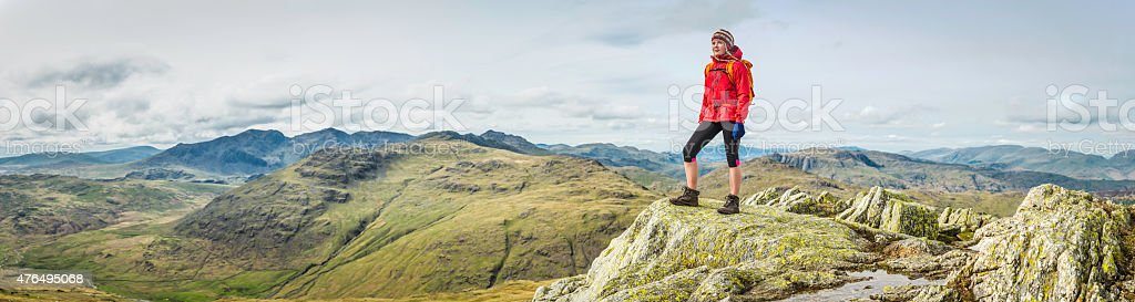 Female hiker looking over wilderness view panorama from mountain top stock photo