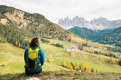 istock Female hiker looks at view 1065043896
