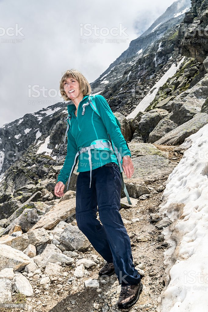 Female hiker on Monte Moro Trail in Switzerland royalty-free stock photo