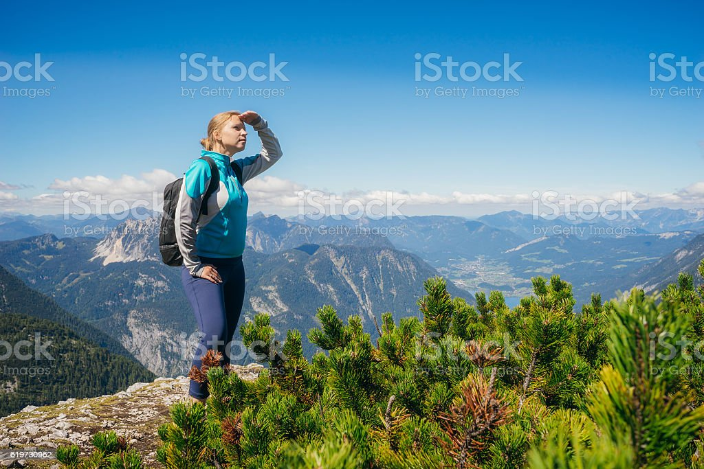 Female hiker on the edge of hill looking at view stock photo