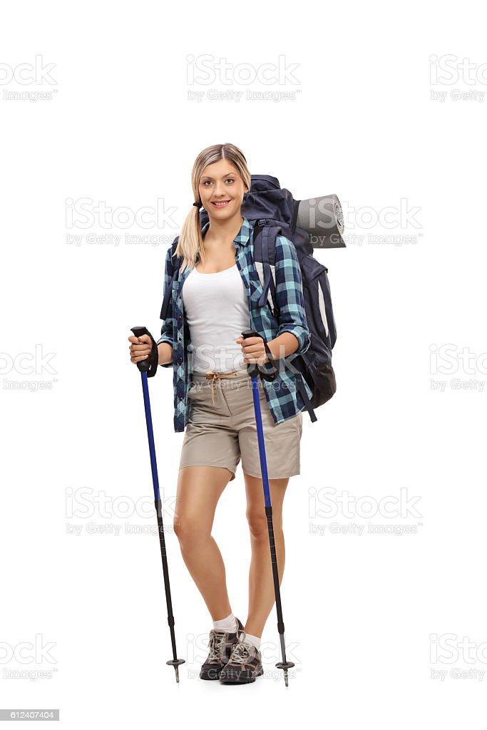 Female hiker posing with hiking equipment stock photo