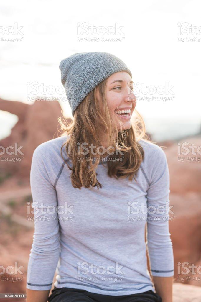 Female hiker relaxes in the Utah desert stock photo
