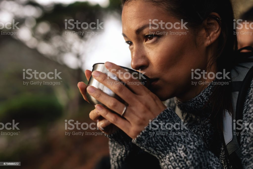 Female hiker taking rest and drinking coffee royalty-free stock photo