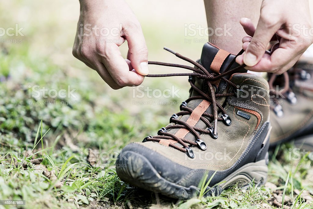 Female hiker tying boot laces royalty-free stock photo