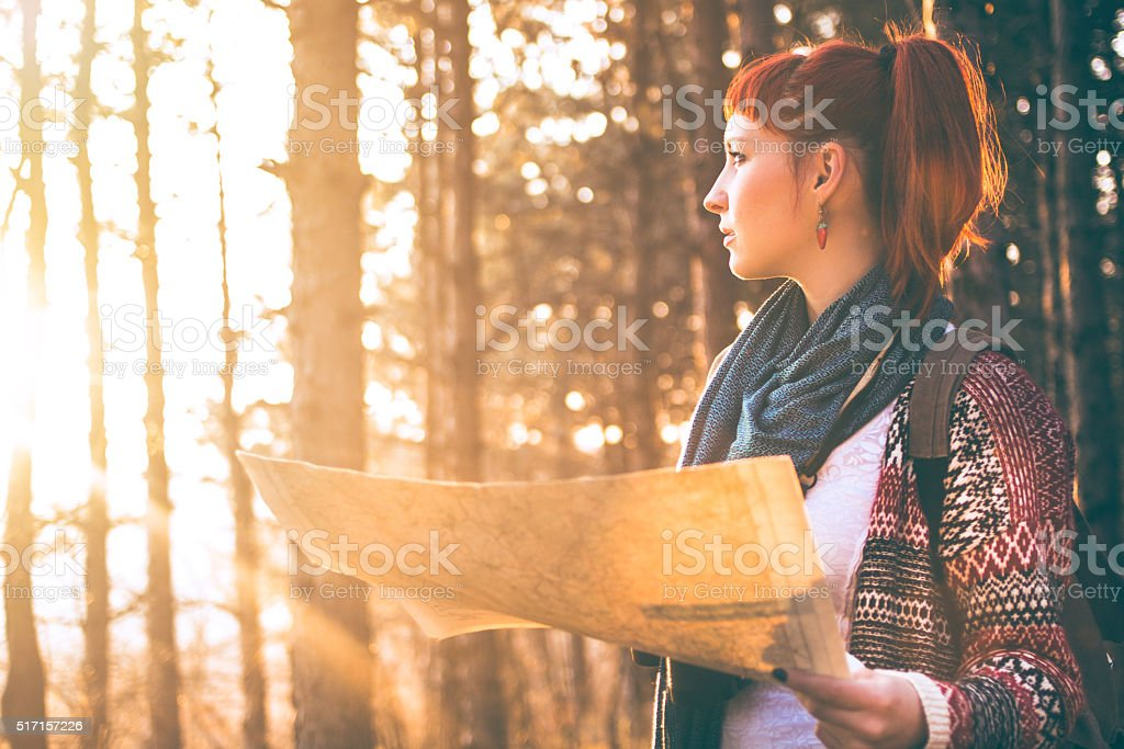Female hiker walking in the sunny mountain forest stock photo