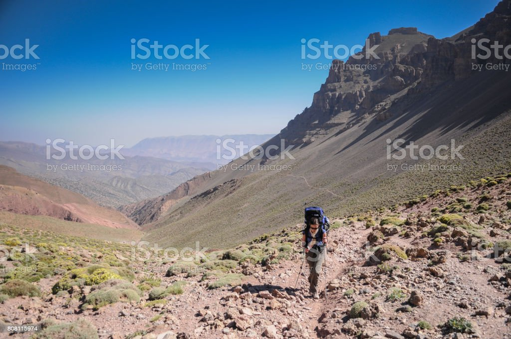 Female Hiker walking up a mountain pass stock photo