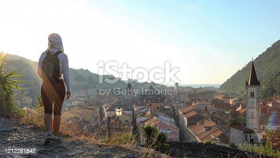 istock Female hiker walks up cobble stone path at sunrise 1212281842