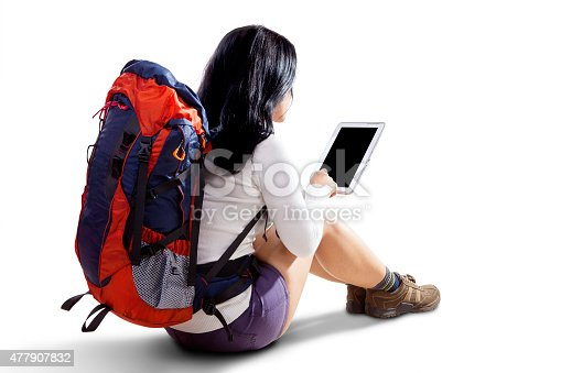 istock Female hiker with tablet in studio 477907832