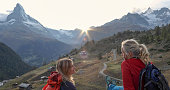 They take smart phone pic of the Matterhorn and village below