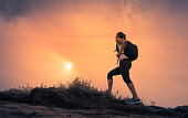 istock Female hiking cross country 1158891054