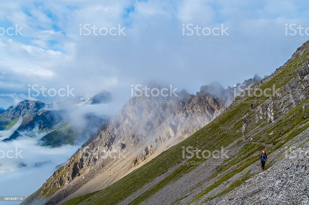 Female hiking in the mountains of Lechtal Alps, Austria stock photo