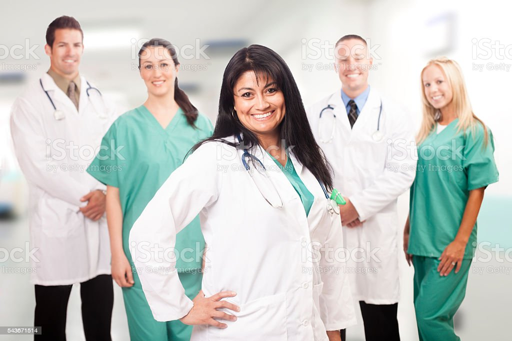 Female Hispanic Doctor with her Medical Team stock photo