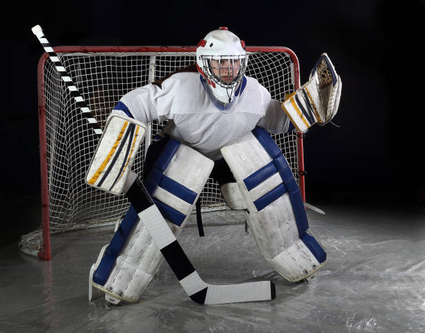 Female Hockey Goalie Guards The Net Stock Photo More Pictures Of