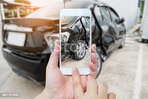 istock female hold mobile smartphone photographing car accident 897157640