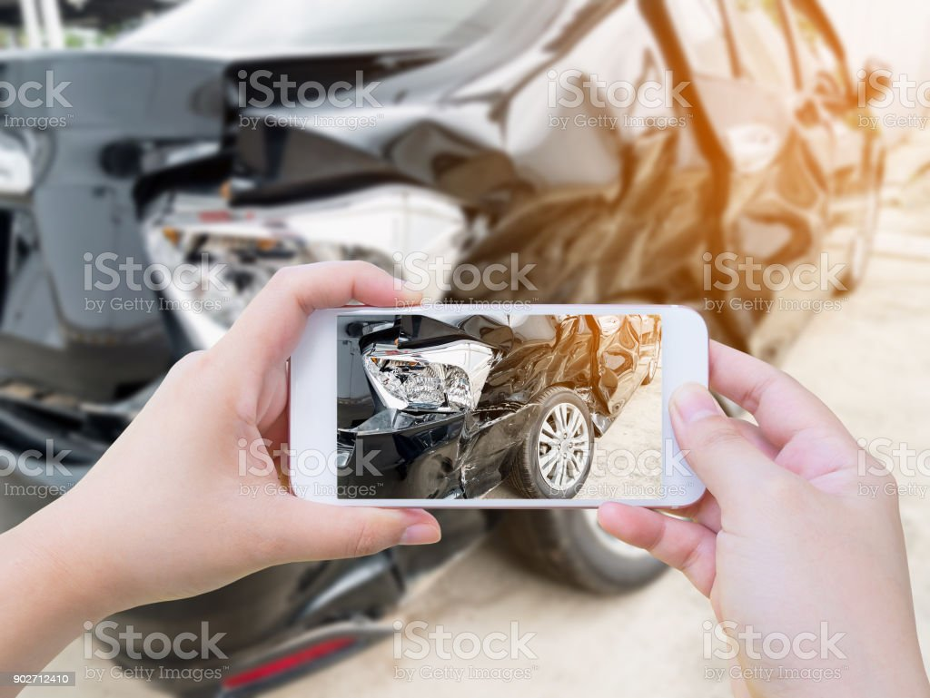 female hold mobile smartphone photographing car accident stock photo