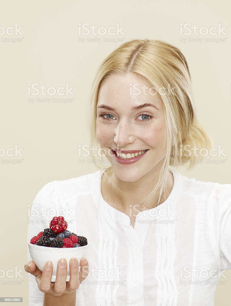 female holding bowl of mixed berries royalty-free stock photo
